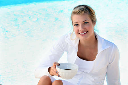hairclip: blonde sitting on the edge of swimming-pool