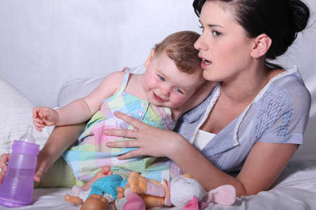 baby nursery: Mother and little baby Stock Photo