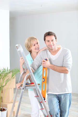 Couple redecorating home photo