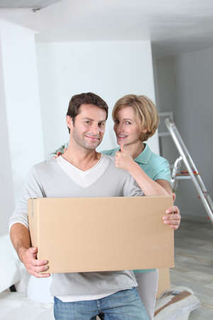 Woman giving the thumbs up to her partner as they move into a new home photo