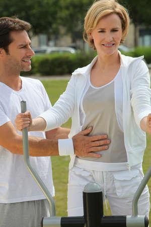 Couple doing exercise photo