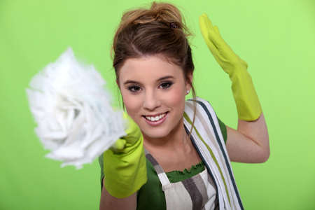 Fun woman doing household chores photo