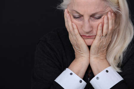 feeling: senior woman looking sad and lonely