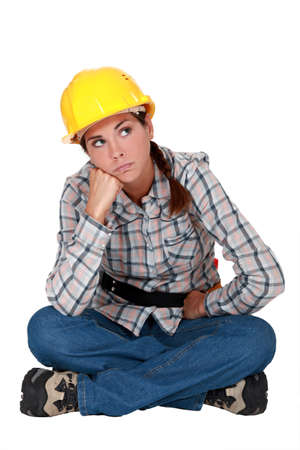 grouch: A grumbling tradeswoman Stock Photo