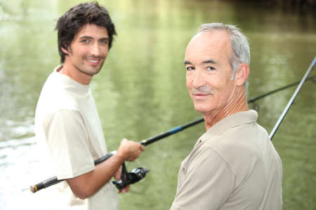 sinkers: father and son fishing Stock Photo