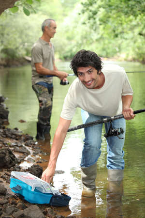 Men fishing in a river Stock Photo - 11603980