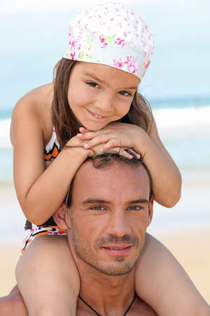 bathing costume: little girl sitting on father