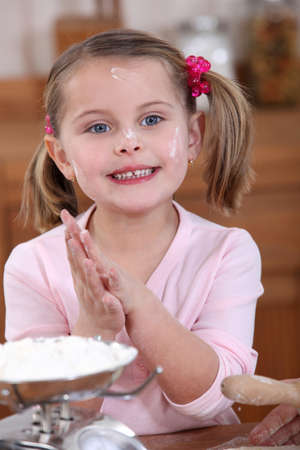 mucky: Little girl baking Stock Photo