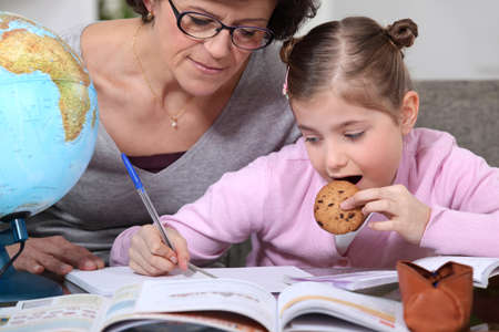 Little girl doing homework Stock Photo - 11603736