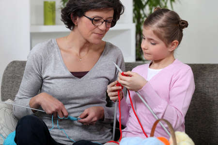 Mother and daughter knitting photo