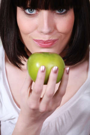 Closeup of a woman with a green apple photo