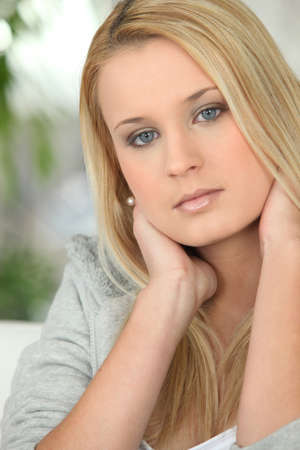 blonde  blue eyes: Portrait of a young woman Stock Photo