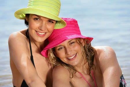 Portrait of two women at the beach photo