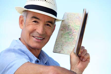 55 60 years: Man looking at an atlas