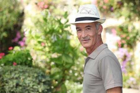 mature gentleman in garden photo