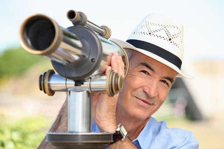 senior watching through a telescope photo