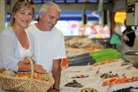 fish shop: Couple at the market together