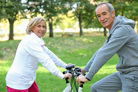 Middle-aged couple on bike ride photo
