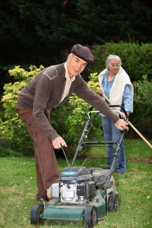 Elderly couple gardening photo