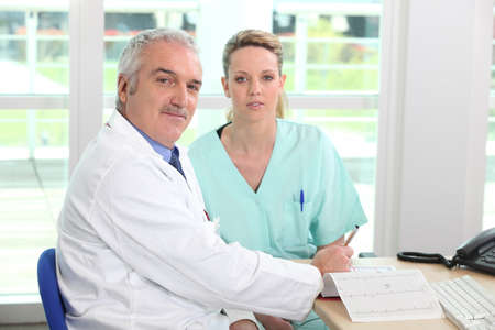 Doctor with his assistant photo