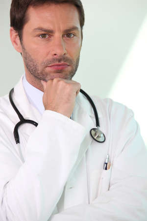 trained nurse: Worried male doctor