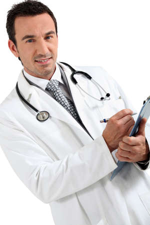 Doctor writing on clipboard smiling photo