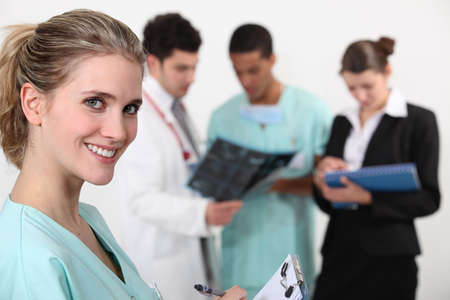 health professionals: A team of doctors conferring Stock Photo