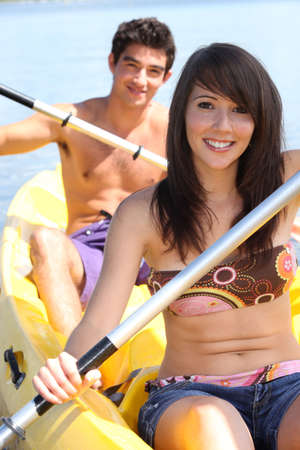 Couple kayaking on a warm summer photo
