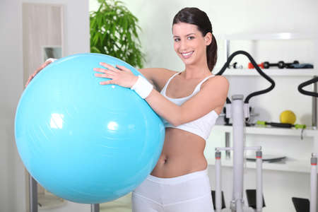 young woman holding a gym ball photo