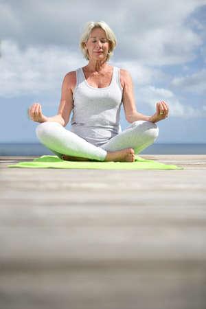 Senior woman doing yoga exercises Stock Photo - 11604077
