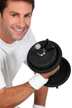 man working out: Man lifting weights Stock Photo