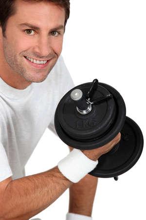 healthfulness: Man lifting weights Stock Photo