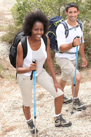 trekking pole: Couple hiking with sticks