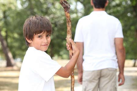 elder tree: boy and adult in garden