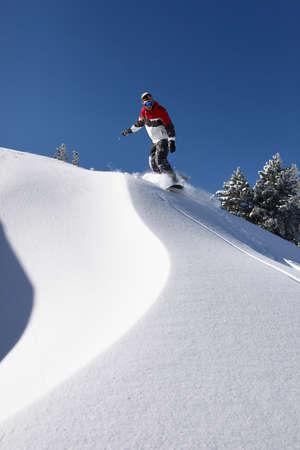 Man snowboarding downhill photo