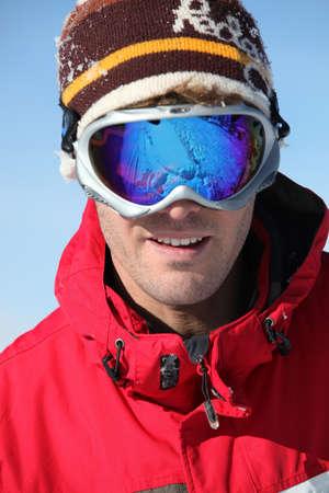 goggle: young man skiing