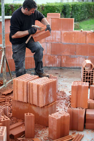 bricklayer building house Stock Photo - 11604144