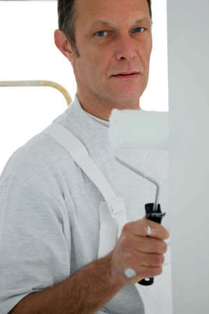 seriousness skill: Man painting a room white