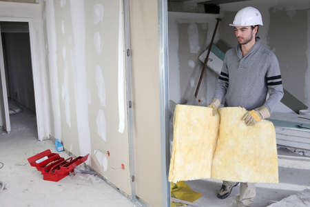 plasterboard: Man building partition