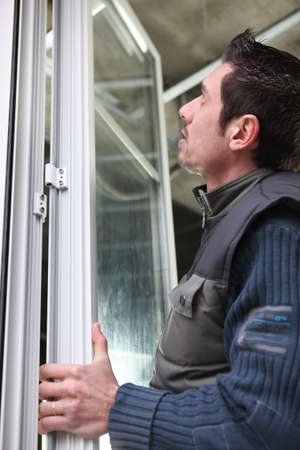 hinge: Man fitting windows