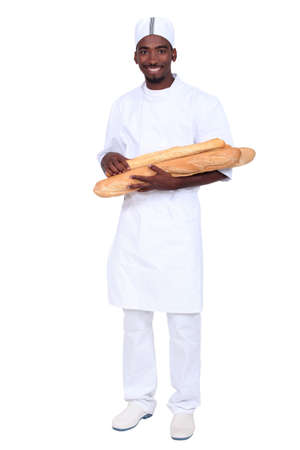 Baker apprentice carrying bread on white background photo