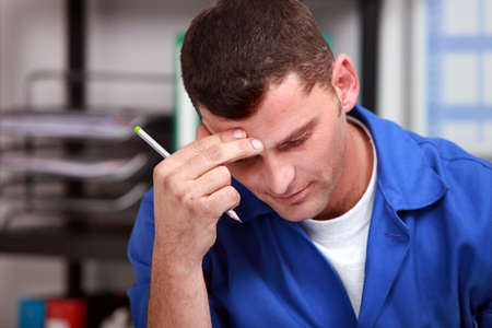 blue collar: After a day of work let do the paperwork. Stock Photo