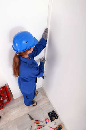 foremaster: Female technician with safety clothing Stock Photo