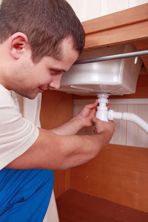 plumber, connecting, pipe under sink Stock Photo - 11610914