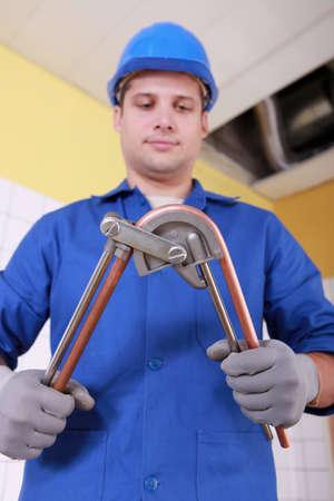 plumbing accessories: Plumber preparing copper pipe