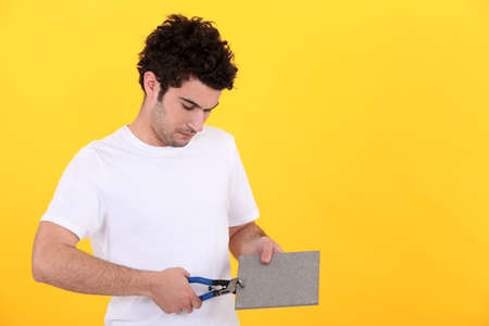 a man working on a tile Stock Photo - 11610242