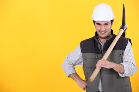 a worker posing with a pickaxe photo