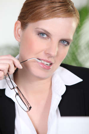 beautiful redhead: Pensive businesswoman Stock Photo