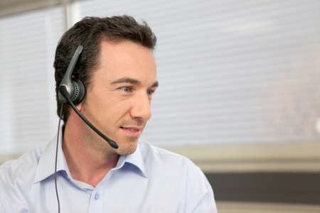 Office worker with headset photo