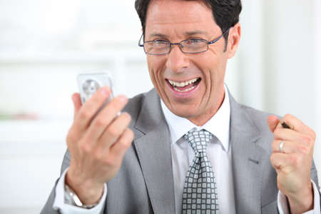 Businessman on the phone laughing Stock Photo - 11606171